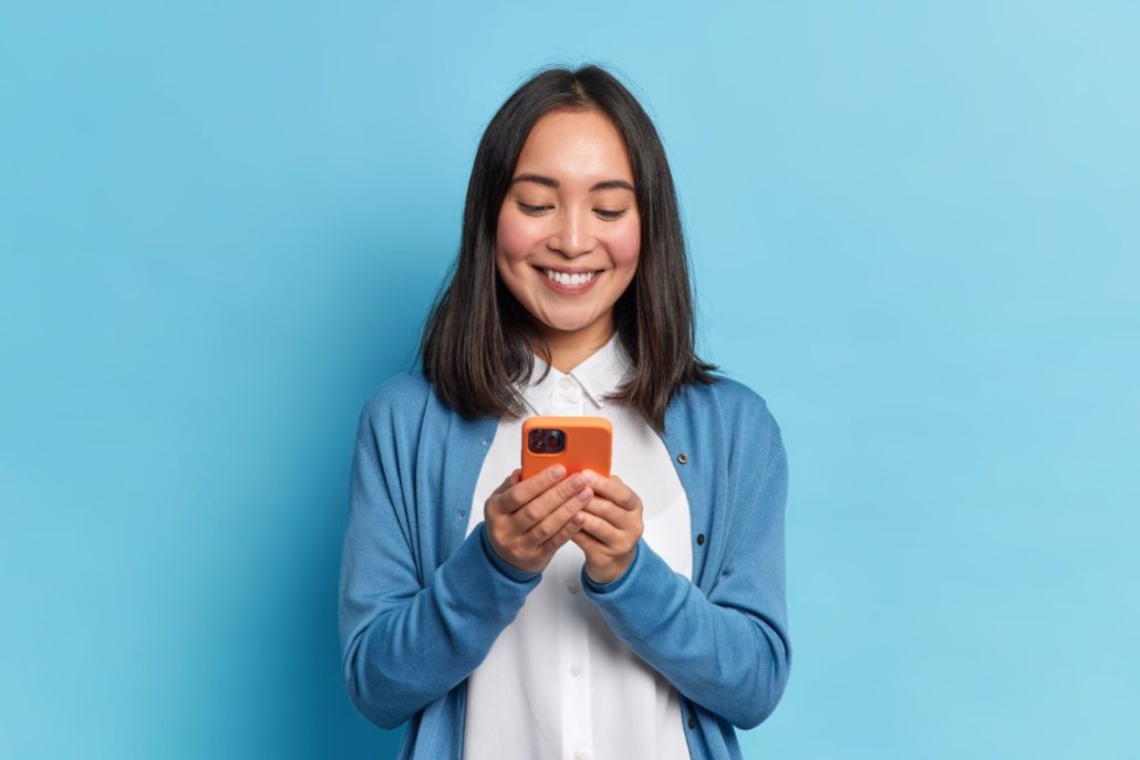 Woman receiving promotional text messages from SMS platform in Portland