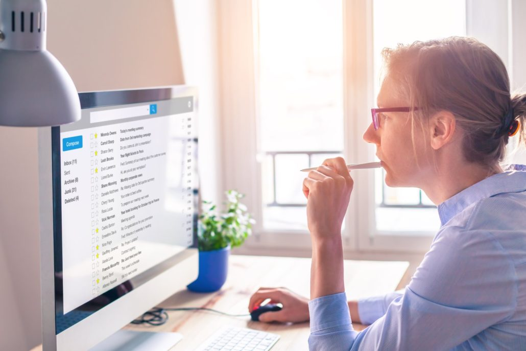 Woman checking promotional email marketing folder in gmail at home
